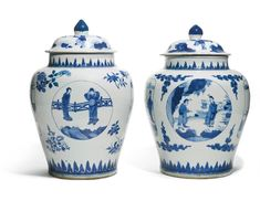 Two blue and white jars and covers, Qing dynasty, Kangxi period, each of baluster form, the exterior with shaped cartouches enclosing ladies in a garden, on a ground of scattered floral sprays or stylised clouds, all between flame-like lappets around the neck and the foot, the domed cover decorated with boys and surmounted by a knob 56.5cm