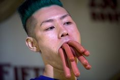 Takeru Kobayashi poses for a photo following his victory in a bunless hot dog eating competition in Manhattan, July 4, 2014. Kobayashi ate 113 hotdogs in what organizers claim was the world's first official bunless hotdog eating competition. REUTERS/Carlo Allegri