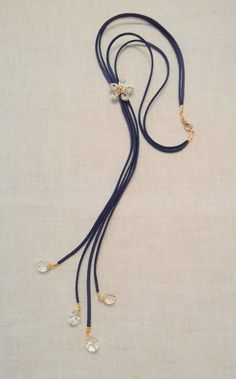 Neclace: leather cords and crystals