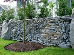 stone sculpture | front entry retaining wall