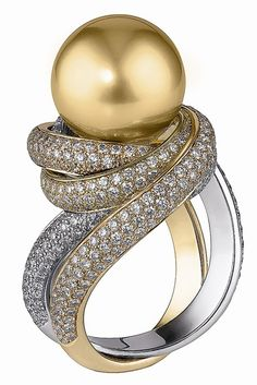 Cartier Trinity Pearls ring--intertwined bands of white, yellow, and rose gold, pave diamonds, gold pearl