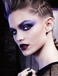 Create an edgy smokey eye by using purple shades instead of the standard black and browns!