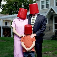 Mother, father and son with buckets by Andy Reynolds #mask #masque #maschera #mascara #head #weird #surreal - Carefully selected by GORGONIA www.gorgonia.it