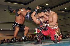 Tomohiro Ishii and Hirooki Goto hitting a hell of a move on EVIL