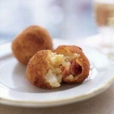 Prosciutto Arancini recipe from Williams-Sonoma. Ingredients: 2 cups chicken broth, 1 cup medium-grain white rice such as arborio, 1 tbs. unsalted butter, pinch of sea salt, . Hot Appetizers, Appetizer Recipes, Snack Recipes, Savory Snacks, Arancini Recipe, Dry Bread, Oil For Deep Frying, Parmigiano Reggiano, Fresh Mozzarella