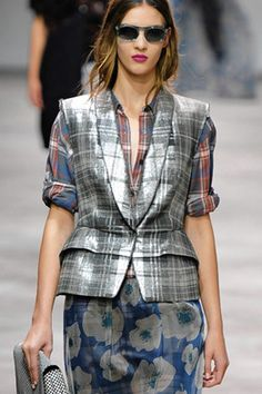 """2000s Designer Work Inspired by 1990s: The 90's """"grunge"""" look takes on a slightly more sophisticated vibe in Dries Van Noten's Spring 2013 collection. The outfits included a large amount of plaid button-up shirts, a iconic grunge clothing item."""