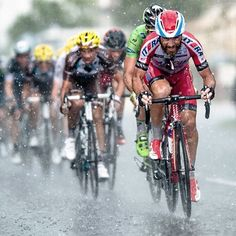 Luca Paolini leading the peloton through a wet and wild stage 15 of the 2014 Tour de France