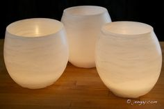 Water Balloon Luminaria-  basically you fill a water balloon, dip it in wax, cool on parchment lined cookie sheet, drain, then smooth tops on warm cookie sheet.