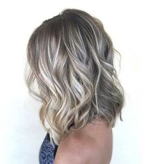 Last but not the least, create some soft waves with your medium length silver platinum hair.