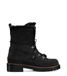 Get the warm and fuzzies from these fur-trimmed boots. These ultra-luxe après-ski essentials feature a lush mink accent that cascades down the shaft, a contrasting buffed wooden heel and a subtle track sole. Wear these chalet-chic must-haves with leather leggings and an off-the-shoulder chunky knit sweater.