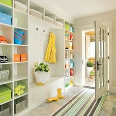 This cheery, one-wall mudroom with cubbies, hooks, and bench can handle a season's worth of athletic gear and outerwear.