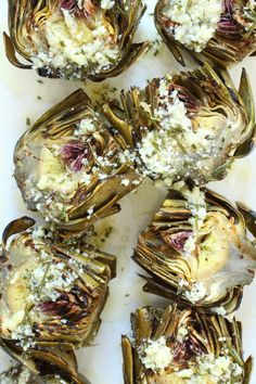Grilled Artichokes w/ Garlic Parmesan Butter  A great side dish for meatless Mondays and so easy to cook!  Use nutritional yeast & coconut oil for a dairy-free alternative.