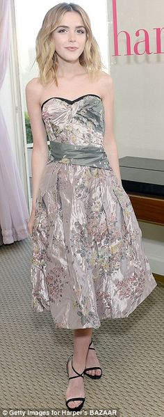 Flower power: The former Mad Men actress looked elegant in a lovely strapless floral numbe...