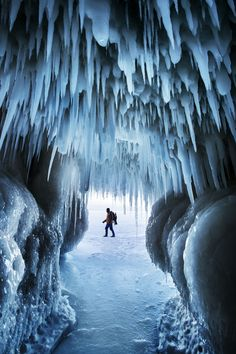 """Ice Ages by Ian Plant on 500px... DESCRIPTION Self portrait taken from inside an """"ice cave"""" on Lake Superior, Apostle Island National Lakeshore, USA. #ApostleIslands #Lake Superior #Wisconsin #cave #cold #frozen #ice #ice cave #icicles #snow #winter"""