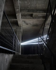 Architect & Artist Jun Ong embedded a 5 story lighting installation within the Malaysian town of Butterworth within the core of an unfinished concrete building. spanning the full height of the architectural skeleton, 'star' pierces through several floors of the disused structure to form a 12-sided, three-dimensional object.