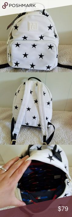 "Tommy Hilfiger Star Design Backpack. 100% Authentic Tommy Hilfiger White and Black Canvas Star Design Backpack,  Brand new with tag,  never worn. Size 11*10*4"" shoulder strap 14"". Tommy Hilfiger Bags Backpacks"
