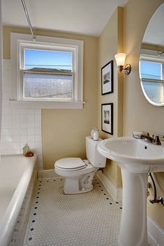 Phinney Ridge Bungalow -  Sherwin Williams Compatible Cream walls warm up this classic bathroom.