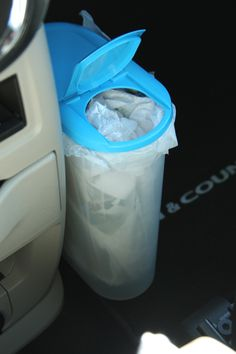 Trash. Keep your car clean from straw wrappers and garbage by placing a plastic grocery sack inside a cereal container with a lift lid. -- I like this one!