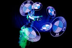 Visual Pixel Poi dancer with BMW logo.  Visual Pixel Poi technology (also known as graphic juggling with LED poi) enables dancers and performers to display graphic elements during the performance that will become a part of the Fire or UV Light show.  http://antaagni.com/visual-pixel-show/