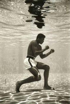 Mohammed Ali poised underwater in Miami. photo by Flip Schulke via Retronaut