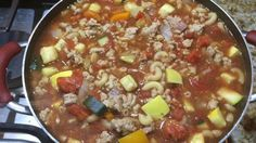 Chopped fresh tomatoes, green bell pepper and zucchini are cooked in a broth of onion soup mix with browned ground beef and cooked macaroni noodles.