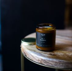 It's a beautiful morning at the beach house. Immerse yourself in the summer vacation smells of sweet fig, fresh laundry, miniature seashells and driftwood. This scented soy candle is infused with fig and jasmine essential oils. Features - 8 oz. reusable amber jar - Beautiful bronze lid - 30 hours of long-lasting scent - We recommend this size for medium size rooms Simple Ingredients - 7.2 oz. of soy wax grown in America - Phthalate-free fragrance infused with essential oils - 1 (one) metal-free Fall Candles, Soy Wax Candles, Candle Jars, Jasmine Essential Oil, Natural Essential Oils, Photo Candles, Beautiful Morning, Driftwood, Fig