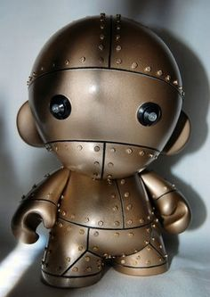 Robot Munny with rivets and light-up eyes