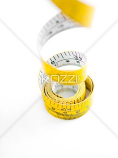 dangled tape measure - Dangled tape measure on a white surface.