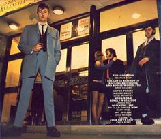 Teddy Boys outside a Cinema in Victoria, London in  1971, pose for the cover of a budget Contour LP 'CRAZY ROCK' : Ray Flight, Don Dolby and Girl and Driftin' Den Board.