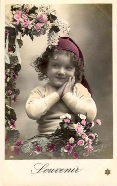 Vintage little girl with pink roses and hat.