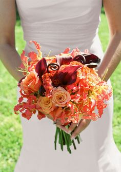 Vibrant bouquet of calla lilies, roses, orchids and fiddlehead ferns by Hunt Littlefield.