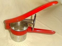 $10....Vintage Red Handle Antique Potato Ricer - Old Enamel- Kitchen Wall Decor (03/05/2014)