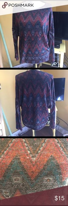 Tribal Sweater Thin material. Super comfortable! Only worn a few times. Bought at Francesca's brand is Miami. Francesca's Collections Sweaters