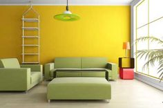 This living room has an analogous color scheme. This is seen in the dominant yellow wall in the background with the yellow-green couches and light fixture and the yellow-orange table lamp.