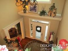 decorative ledge over entry door, plant ledge , two story foyer with shelf above door with window.  Z