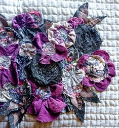 This is a 27 page PDF Download Tutorial Floral embellishing is a form of textile and fabric art. The use of floral embellishments is known through the ages as a means of enriching textile art, by creating a style of patchwork using fabric flowers.
