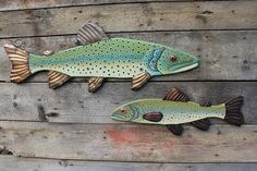 The Brown Trout species is a large fish that's known for its long lifespan and being difficult to catch. Maybe that's why the brown trout painting in Rachel's Fish Series has an air of nonchalance abo