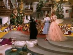 """You can clearly see the trap door open in the scene where the Wicked Witch departs Munchkinland. 