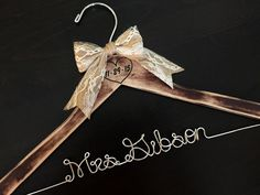 A personal favorite from my Etsy shop https://www.etsy.com/listing/158817918/rustic-bridal-hanger-shabby-chic-brides