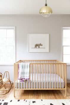 nursery design // baby rhino artwork by Sharon Montrose // ikea crib