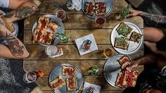While it isn't American by origin, we've done everything we can to perfect and retool the classic Italian dish to the point where it is hard to call it anything but one of our nation's favorite foods. From thin to thick, loads of toppings to basically naked, wood smoked or pan-fried, these twenty places