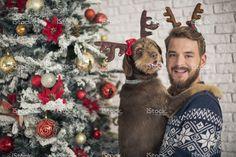Man with his dog hugging for christmas. stock photo 75269975 - iStock