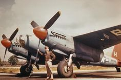 """An airman of the Bombardment Squadron, Bombardment Group poses with de Havilland Mosquito PR Mk XVI """"H"""" New Aircraft, Military Aircraft, Rolls Royce Merlin, De Havilland Mosquito, American Air, United States Army, Royal Air Force, Wwii, Fighter Jets"""