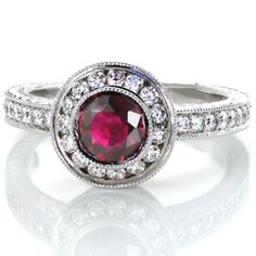Did you know the element that makes up Ruby is Corrundum? This is the same element that makes up Sapphire. This beautiful halo design contains micropave detail and hand engraving.   Ruby Monarch from Knox Jewelers