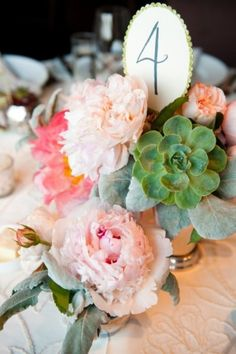 Blush and pink peonies, succelents, dusty miller.