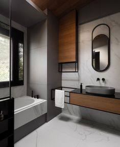 In this modern grey, black, and wood bathroom, curved elements like the mirror and the basin reflect the curved interior shape of the bath. best bathroom decor Chevron Patterns And High Ceilings Can Be Found Throughout This Home In Kiev Contemporary Interior, Modern Interior Design, Interior Design Inspiration, Design Ideas, Design Trends, Design Blogs, Design Fails, Simple Interior, Nordic Interior