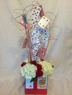 Playing cards centerpiece for Alice in Wonderland Sweet 16 - Flowers by Floyd Harbor