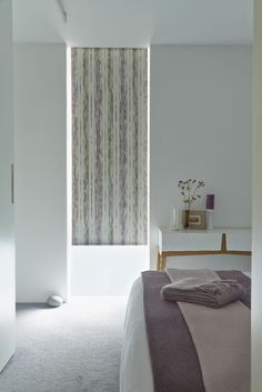 Our Flock Plum Roller blind is super stylish, featuring unusual stripes and a gorgeous purple design. It's great as used here, to accentuate long windows, but will also make small ones look longer. We like the soft design when used in a bedroom, but it will look just as gorgeous in a kitchen or living room.: