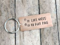 Dog Quote Key Ring - Dog Lover Gift - Love Walks on Four Paws - Paw Prints - Stamped Copper Metal Keychain by ATwistOfWhimsy on Etsy https://www.etsy.com/listing/479206430/dog-quote-key-ring-dog-lover-gift-love