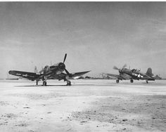 Two F4U-1A Corsair aircraft of VMF-113 on the ground on Engebi Island in the Pacific 1945